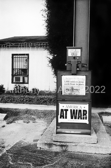 Fayetteville, North Carolina.USA.2003..American Newspaper boxes advertise the war in Iraq.