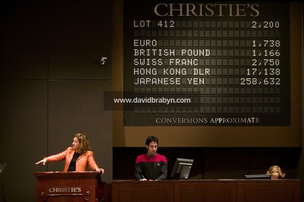 6 October 2006 - New York City, NY - An auctioneer (L) and her assistant dressed in a Starfleet costume collect bids during the auction sale of items from the television show Star Trek at Christie's auction house in New York City, USA, 6 October 2006.