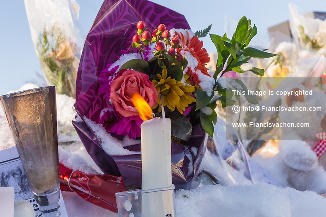 Signs and flowers are seen outside the Grande Mosquée de Quebec (Centre Culturel Islamique de Quebec), Thursday February 2, 2017. Sunday January 29, a shooter left six worshippers dead at this Quebec city mosque.