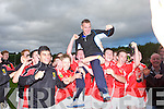 The East Kerry minor team hold up manager James Fleming after winning the minor County championship final at Killorglin on Saturday.