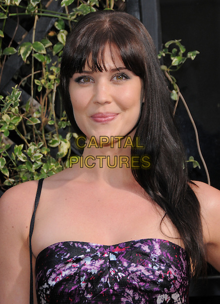 SARAH LANCASTER.The Eva by Eva Longoria Fragrance Launch held at Beso in Hollywood, California, USA. .April 27th, 2010.perfume headshot portrait fringe bangs hair pink purple floral print black pattern.CAP/RKE/DVS.©DVS/RockinExposures/Capital Pictures.