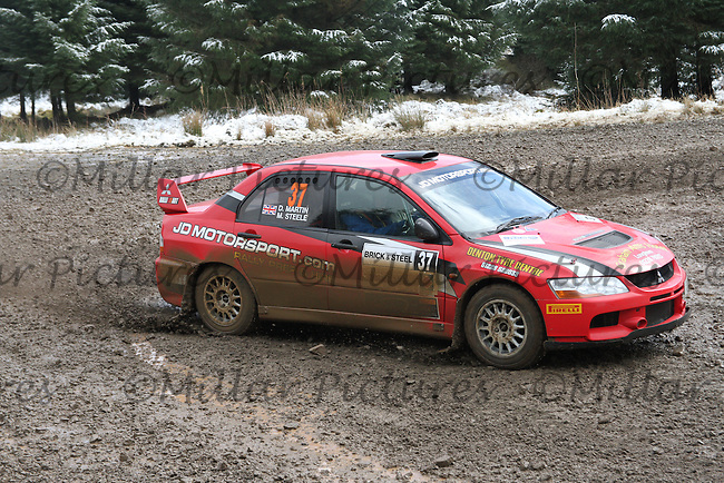 Darren Martin - Martin Steele in a Mitsubishi Lancer Evolution 9 at Junction 6 on Special Stage 1 Riccarton on the Brick & Steel Border Counties Rally 2014, Round 2 of the RAC MSA Scottish Rally Championship sponsored by ARR Craib Transport Limited and other championships  and organised by Whickham & District and Hawick & Border Car Clubs and based in Jedburgh and held in Kielder Forest on 22.3.14.