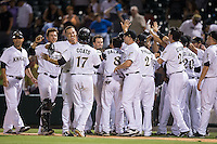The Charlotte Knights celebrate their walk-off win over the Indianapolis Indians at BB&T BallPark on June 20, 2015 in Charlotte, North Carolina.  The Knights defeated the Indians 6-5 in 12 innings.  (Brian Westerholt/Four Seam Images)