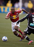 Red Bulls (2) Marvell Wynne is defended by DC United's (9) Freddy Adu during the second half. DC United defeated the Red Bulls 4-1 at Giant's Stadium, East Rutherford, NJ, on April 22, 2006.