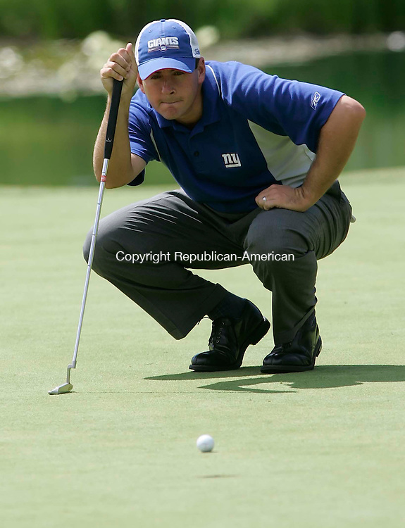 CROMWELL, CT 26 AUGUST 2005 082605BZ09-  Ben Curtis looks over his line before making a putt on #8<br /> during the second round of the Buick Championship at the TPC at River Highlands Friday. <br /> Jamison C. Bazinet / Republican-American