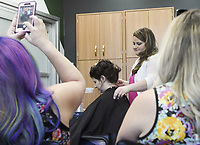"""NWA Democrat-Gazette/CHARLIE KAIJO Kasey Coonrod of Bentonville (center right) works on the hair of Anna Sarratt during a formal hair class, Monday, May 13, 2019 at Sola Salons in Bentonville.<br /> <br /> """"A lot of stylists are new to this industry or want more confidence in this area and the best way is through education,"""" Kasey Coonrod said of her reason to have the class. """"Some stylists are intimidated by weddings and formal events."""""""