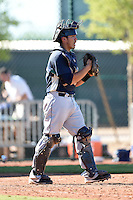 Seattle Mariners catcher Yojhan Quevedo (60) during an Instructional League game against the Cleveland Indians on October 1, 2014 at Goodyear Training Complex in Goodyear, Arizona.  (Mike Janes/Four Seam Images)