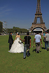 Asian couple getting married at the Eiffel Tower, Paris, France.