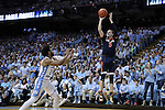 18 February 2017: Virginia's Kyle Guy (5) shoots over North Carolina's Joel Berry II (2). The University of North Carolina Tar Heels hosted the University of Virginia Cavaliers at the Dean E. Smith Center in Chapel Hill, North Carolina in a 2016-17 Division I Men's Basketball game. UNC won the game 65-41.