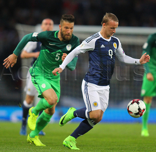 March 26th 2017, Hampden Park, Glasgow, Scotland; World Cup 2018 qualification football, Scotland versus Slovenia;  Leigh Griffiths brings the ball forward chased down by  (slov)