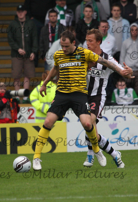 Anthony Stokes being pressured by Jeroen Tessalaar in the St Mirren v Celtic Clydesdale Bank Scottish Premier League match played at New St Mirren Park, Paisley on 28.8.11