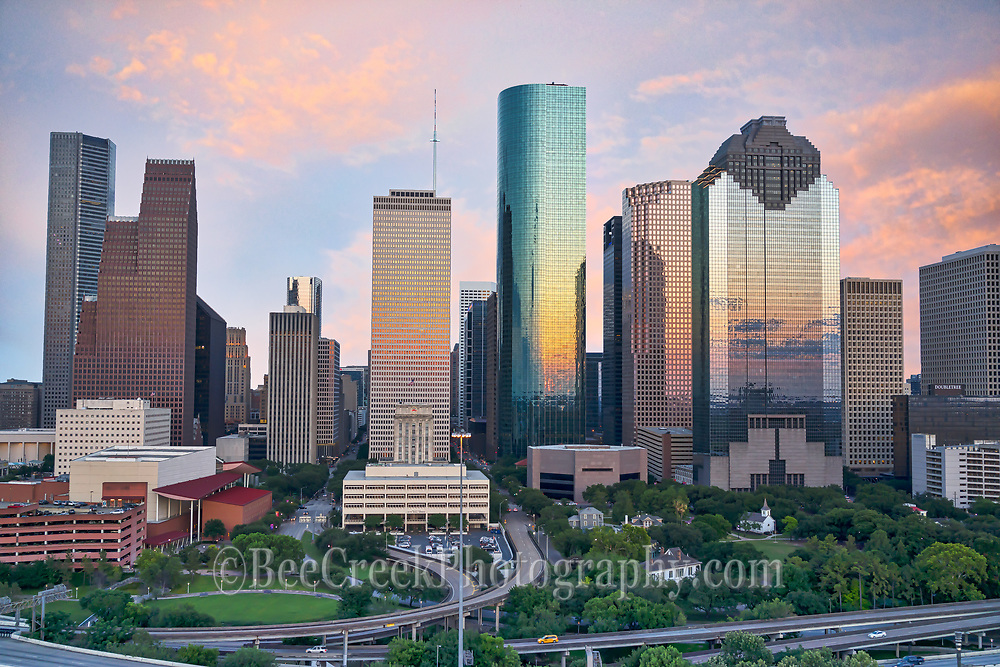 This was another capture of the Houston skyline.  Capture this aerial image of Houston Skyline right as the sun was setting and as it was going down it started to back light these wonderful clouds over the city with these wonderful colors of orange, pinks and yellows. Houston is a large city with a population around 2.3 million people which makes it the fourth most populous city in the US. Houston is also the largest city in the southern united states. This area of Houston is located near the Buffalo Bayou and home to theater district with nine major performing arts group plus six performance halls.  The skyline of Houston is very impressive site with some of the tallest and modern mirrored skyscrapers buildings in the US. In this image you can see the Heritage Plaza at 762 ft, Wells Fargo 992 ft, and the tallest building in Houston the J P Morgan Chase Tower at 1002 ft and it the 17 tallest in the US. This urban area almost always has something going on and today we capture another great skyline with a beautiful sunset over the city.