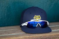 A Charleston RiverDogs cap sits in the home dugout at Joseph P. Riley, Jr. Park prior to the game against the Greenville Drive on May 26, 2014 in Charleston, South Carolina.  The Drive defeated the RiverDogs 11-3.  (Brian Westerholt/Four Seam Images)