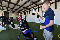 NWA Democrat-Gazette/FLIP PUTTHOFF <br /> LEARNING THE GAME<br /> Caleb Stevens, 10, of Rogers finishes a group golf lession on Saturday March 16 2019 at The First Tee of Northwest Arkansas on Lowell. Youth golfers worked with coaches on their skills with irons and drivers during the lesson. Mission of The First Tee is to impact young people through programs that build character, instill values and promote heahthy choices through the game of golf.
