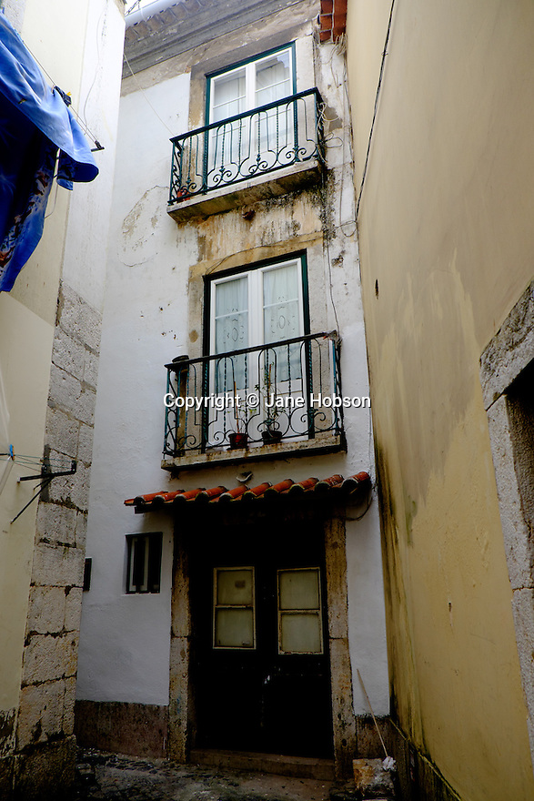 Lisbon, Portugal. 21.03.2015. Typical housing in a narrow street in the Alfama district of Lisbon. © Jane Hobson.