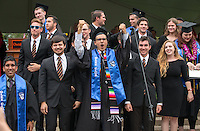 Michael Amador Schulze, center. The class of 2015 graduates during Occidental College's 133rd Commencement, the Remsen Bird Hillside Theater, on Sunday, May 17, 2015.<br />