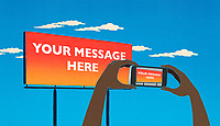 Taking cell phone picture of billboard saying 'Your Message Here'