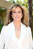 ***FILE PHOTO*** Felicity Huffman and Lori Loughlin Indicted in College Admission Bribery Case.<br /> BEVERLY HILLS, CA - APRIL 16: Felicity Huffman, At Eva Longoria's Hollywood Star Ceremony Post-Luncheon  At Private Residence in Beverly Hills, California on April 16, 2018. <br /> CAP/MPIFS<br /> &copy;MPIFS/Capital Pictures