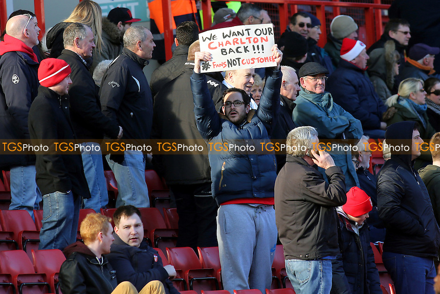 A Charlton fan holds aloft a protest banner during Charlton Athletic vs Middlesbrough, Sky Bet Championship Football at The Valley on 13th March 2016