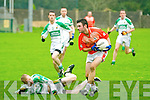 Brosna's Tom Fitzgerald secures the ball from a failed tackle by Ballydonoghue's Daniel Riordan.