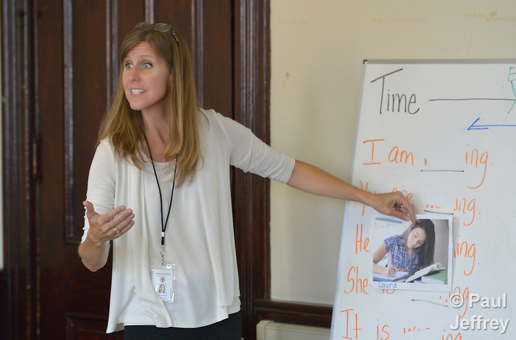 Penny Gushiken leads a cultural orientation class for newly arrived refugees in a church in Lancaster, Pennsylvania. The class, which includes learning common English phrases, is sponsored by Church World Service. <br /> <br /> Photo by Paul Jeffrey for Church World Service.