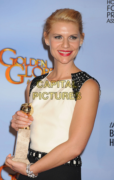 Claire Danes.Press Room at the 69th Annual Golden Globe Awards held at the Beverly Hilton Hotel, Hollywood, California, USA..January 15th, 2012.globes half length black white sleeveless dress award trophy winner red lipstick  .CAP/GDG.©GDG/Capital Pictures