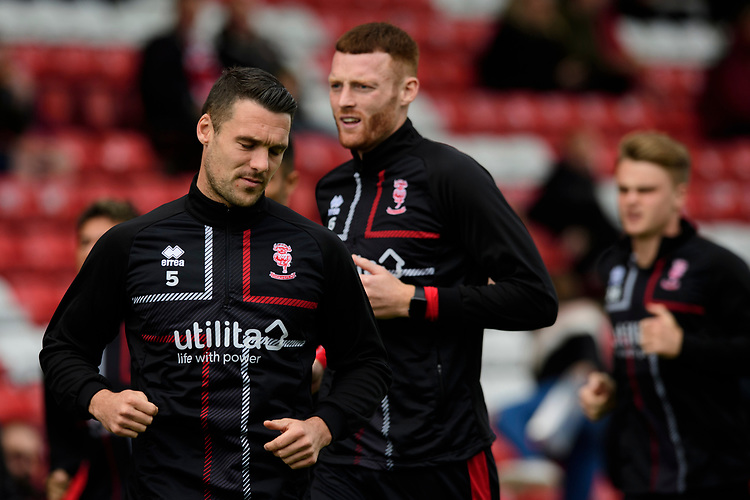 Lincoln City's Jason Shackell, left, with team-mate Cian Bolger during the pre-match warm-up<br /> <br /> Photographer Chris Vaughan/CameraSport<br /> <br /> The EFL Sky Bet League One - Lincoln City v Sunderland - Saturday 5th October 2019 - Sincil Bank - Lincoln<br /> <br /> World Copyright © 2019 CameraSport. All rights reserved. 43 Linden Ave. Countesthorpe. Leicester. England. LE8 5PG - Tel: +44 (0) 116 277 4147 - admin@camerasport.com - www.camerasport.com