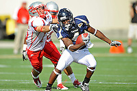 9 October 2010:  FIU wide receiver T.Y. Hilton (4) evades Western Kentucky cornerback Ryan Beard (15) in the second quarter as the FIU Golden Panthers defeated the Western Kentucky Hilltoppers, 28-21, at FIU Stadium in Miami, Florida.
