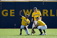 Michigan Wolverines outfielders Johnny Slater (25), Miles Lewis (3) and Jonathan Engelmann (2) celebrated defeating the Illinois Fighting Illini during the NCAA baseball game on April 8, 2017 at Ray Fisher Stadium in Ann Arbor, Michigan. Michigan defeated Illinois 7-0. (Andrew Woolley/Four Seam Images)