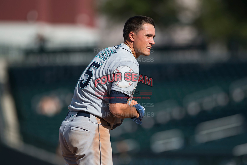 Peoria Javelinas first baseman Evan White (15), of the Seattle Mariners organization, questions a strike three call during an Arizona Fall League game against the Mesa Solar Sox at Sloan Park on October 24, 2018 in Mesa, Arizona. Mesa defeated Peoria 4-3. (Zachary Lucy/Four Seam Images)