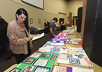 NWA Democrat-Gazette/FLIP PUTTHOFF<br /> HISTORY ON DISPLAY<br /> Sara Kennard (cq) judges the poster category Saturday March 3 2018 at the regional National History Day contest held at Northwest Arkansas Community College. Some 450 Northwest Arkansas middle school and high school students took part in the contest, hoping to advance to the state competition. Categories included performances, posters, documentaries, exhibits, papers and websites.