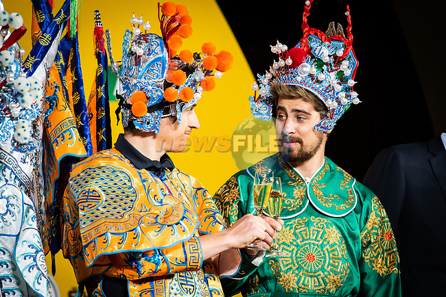 Yellow Jersey Geraint Thomas (WAL) and Green Jersey Peter Sagan (SVK) toast one another wearing full Bejing Opera costumes on stage at the media day before the 2018 Shanghai Criterium, Shanghai, China. 16th November 2018.<br /> Picture: ASO/Pauline Ballet | Cyclefile<br /> <br /> <br /> All photos usage must carry mandatory copyright credit (&copy; Cyclefile | ASO/Pauline Ballet)