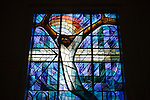 A stained glass window donated by the people of Wales is seen in the back of the sanctuary of 16th Street Baptist Church on August 13, 2013 in downtown Birmingham, Alabama. In 1963, four girls were killed when a bomb under the church's side steps went off.