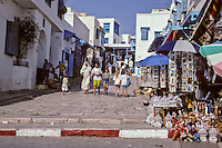 Tunisia, Sidi Bou Said.  Main Street, leading to the Mosque and the Cafe des Nattes.  Women in Traditional and Western Dress.