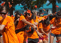 NWA Democrat-Gazette/JASON IVESTER <br /> Advanced Placement Spanish Language and Culture students from Springdale High and Springdale Har-Ber participate on Thursday, Sept. 17, 2015, in the 10th annual Tomatina Celebration at Murphy Park in Springdale. See more photos at nwadg.com/photos.