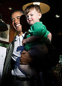 United States President Barack Obama (L) holds Danny Cooper Coleman, age 21 months, as he visits a bar in celebration of St. Patrick's day at the Dubliner Restaurant and Pub on March 17, 2012 in Washington, DC. Next week, Obama and Vice President Biden will meet the Irish Prime Minister Enda Kenny and attend a St. Patrick's Day lunch at the Capitol. .Credit: Joshua Roberts / Pool via CNP