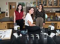 "Audrey Shawley '18 (white top), a biochemistry major from San Francisco, Nina Doeff '18 (red top), a mathematics and Spanish studies major from Evanston, Ill., and Hannah Hayes '18 (black top), a biology major from Arizona, founded Boundless Brilliance, a nonprofit organization that encourages young girls to pursue careers in STEM (science, technology, engineering, and mathematics) by showing them it can be done.<br /> In 30-minute presentations to kindergarten to sixth-grade students, Boundless Brilliance's teams of college students, all women currently attending Occidental, go into classrooms to create excitement about science. Through simple experiments (such as building a bridge between two chairs using only newspapers and tape—remember newspapers?) and a message couched in confidence, respect, and teamwork, their message to everyone—and young girls in particular—is simple: You are brilliant and you can be a scientist if you want to be.<br /> In the fall semester, Boundless Brilliance gave more than 100 presentations at six different schools, reaching more than 2,500 students. This spring, the group hopes to double that number. In the near future, Boundless Brilliance aims to expand its program model to five Southern California colleges. ""By the end of 2020, we hope to be able to reach more than 40,000 students each year,"" says Shawley, the group's executive director.<br /> Portrait taken March 9, 2018 in Bioscience 311.<br /> (Photo by Marc Campos, Occidental College Photographer)"