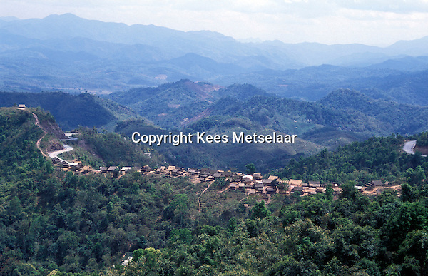 Laos, Xieng Khuang Province..Hmong village, traditionally built on high ridge...Photo by Kees Metselaar, 2003
