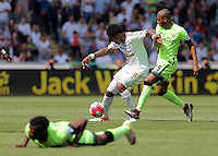 ( L-R ) Leroy Fer of Swansea City against Fernandinho of Manchester City during the Swansea City FC v Manchester City Premier League game at the Liberty Stadium, Swansea, Wales, UK, Sunday 15 May 2016