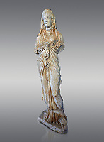 Roman statue of Priestess of Isis,  2nd century AD from Hierapolis. Hierapolis Archaeology Museum, Turkey. Against a grey background