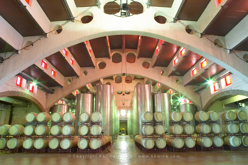 Wine aging in oak barrels. Stainless steel fermentation tanks. Modernista style vaulted winery. Oak barrel aging and fermentation cellar. Fermentation tanks. Raimat Costers del Segre Catalonia Spain
