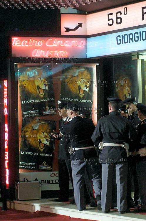 Italia, Sanremo, Festival della canzone italiana. Polizia davanti il teatro Ariston. Italy, Sanremo, Festival di Sanremo the  popular festival of italian music. Policemen outside the Ariston theatre.