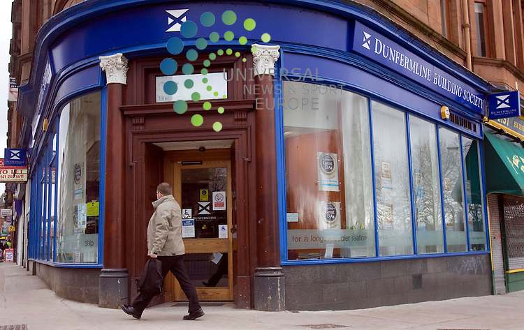 The Nationwide is to buy the Dunfermline Building Society's branches, good loans and deposits.The mutual was put up for sale after incurring losses of &pound;26m.<br /> The Nationwide said the 140-year-old brand would keep its name but that there may be redundancies from its back office and support operations.<br /> Picture: Universal News and Sport 30/3/09