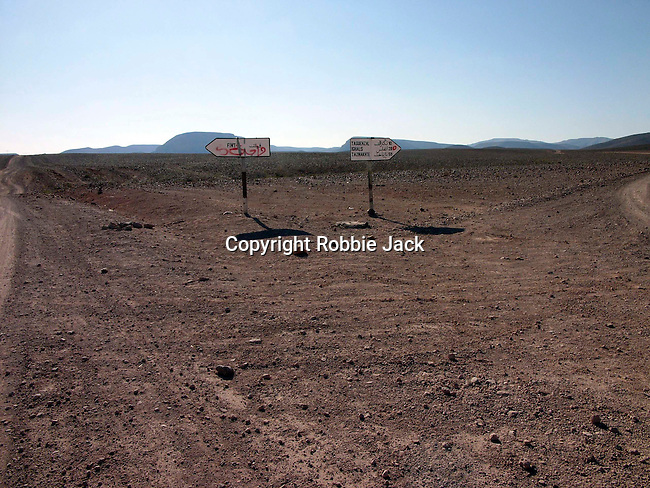 Road signs in the stoney flatland and semi desert near Quarzazate in Morocco.