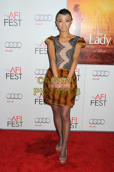 "Bai Ling.AFI Fest 2011 Gala Screening of ""The Lady"" held at Grauman's Chinese Theatre, Hollywood, California, USA..November 4th, 2011.full length skirt top hand on hip black lace pink brown fur clutch bag.CAP/ADM/BP.©Byron Purvis/AdMedia/Capital Pictures."