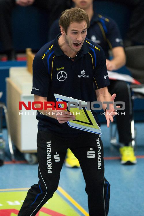08.12.2013, Halle Berg Fidel, Muenster,  Volleyball, Bundesliga Frauen, USC M&radic;ľnster / Muenster vs. Schweriner SC<br />  <br /> <br /> Felix Koslowski (Trainer / Coach Schwerin)<br /> <br />   Foto &not;&copy; nordphoto / Kurth
