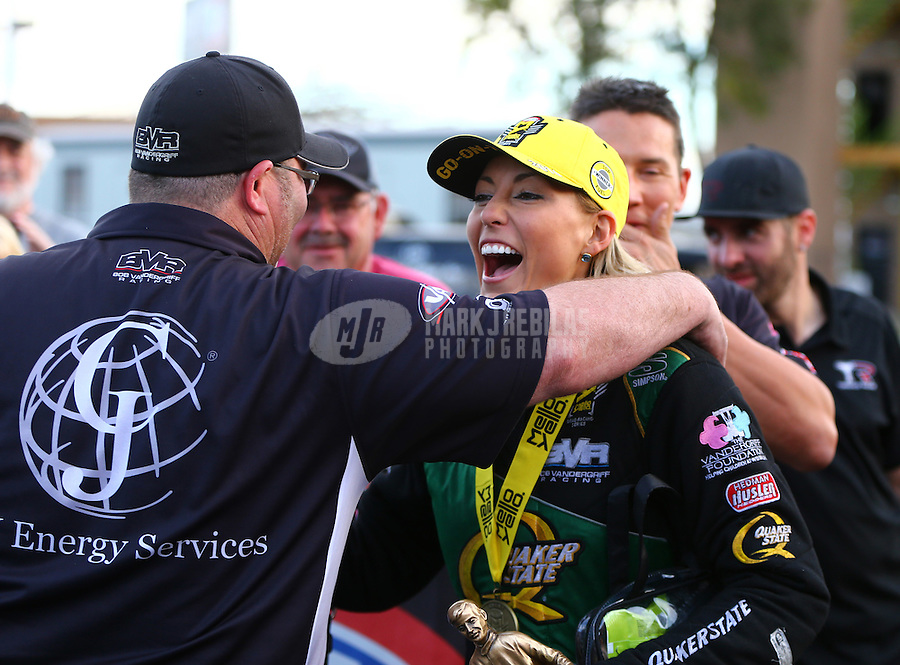Feb 28, 2016; Chandler, AZ, USA; NHRA top fuel driver Leah Pritchett celebrates with crew members after winning the Carquest Nationals at Wild Horse Pass Motorsports Park. Mandatory Credit: Mark J. Rebilas-