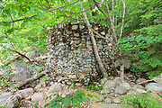 Remnants of a stone water holding tank near the old Civilian Conservation Corps camp which was located near the area of Sawyer River Station. Sawyer River Station was the terminus for the Sawyer River Logging Railroad's connections to the Maine Central Railroad in Harts Location, New Hampshire USA.