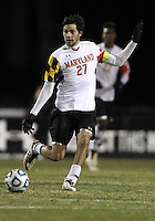 COLLEGE PARK, MD - NOVEMBER 25, 2012: John Stertzer (27) of the University of Maryland  against  Coastal Carolina University during an NCAA championship third round match at Ludwig Field, in College Park, MD, on November 25. Maryland won 5-1.