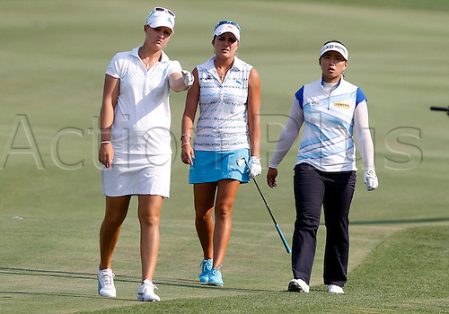 06.07.2012. Kohler, Wisconsin.  Professional Golfers (L to R) Lexi Thompson from Florida, Anna Nordqvist from Sweden, and Amy Yang from Korea converse as they approach the 18th green at Blackwolf Run in the second round of the U.S. Women's Open Championship in Kohler, Wisconsin.